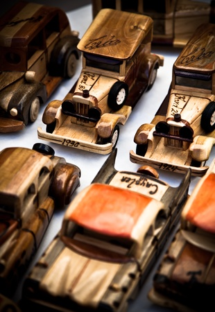 Collection of handmade wooden toy cars with nobody
