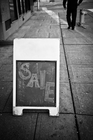 Black and White Boutique Sale Sign on the Street Banco de Imagens