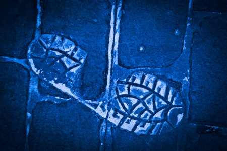 footmark: Human Footprint on a Blue Concrete floor
