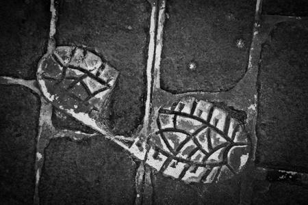 Human Footprint on a Grey Concrete floor