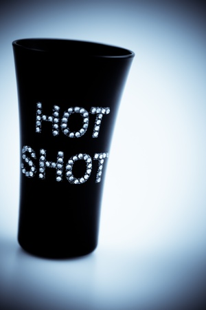 Small Black Shot Cup Concept with gray text (Hot Shot) Banco de Imagens