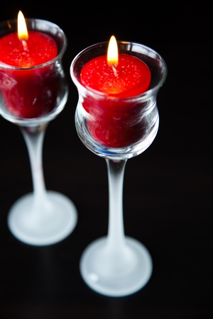 Two Red Candles on a Black Background