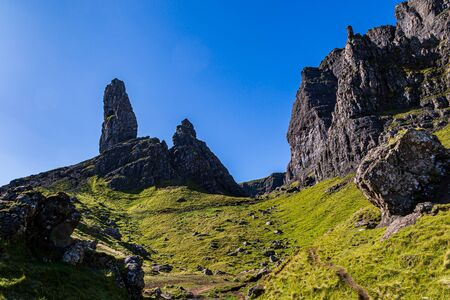 Looking up at the rocky landscape of The Old Man of Storr on the Isle of Skye