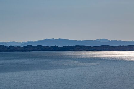 Looking out to sea from the Isle of Skye with a clear blue sky overhead Standard-Bild
