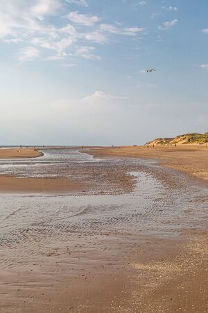 Looking along the sandy beach at Formby in Merseyside, on a sunny summers day Stockfoto