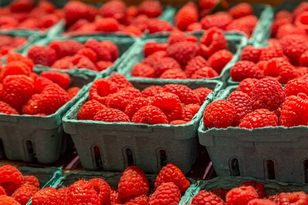 A display of raspberries for sale on a market stall Banco de Imagens