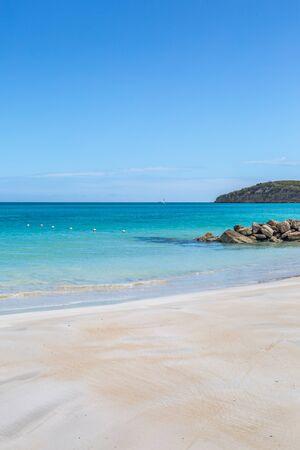 An idyllic sandy beach on the Caribbean Island of Antigua