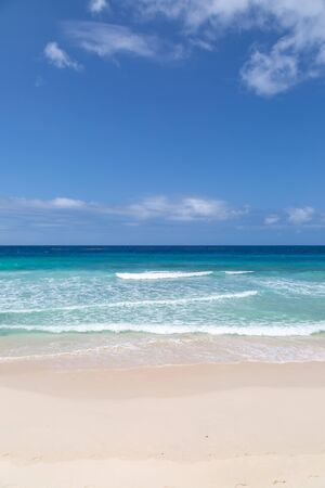 Looking out to sea from an idyllic beach on the caribbean island of Barbados Stock Photo