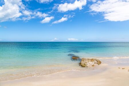 An idyllic sandy beach on the Caribbean Island of Antigua