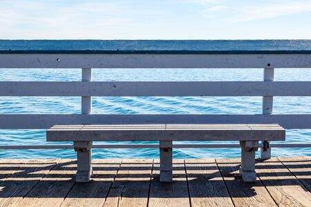 A bench on San Clemente Pier in California, overlooking the ocean