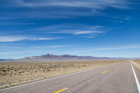 Looking along the Extraterrestrial Highway running through the remote Nevada Desert Stock Photo