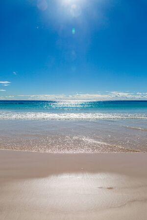 The sun shining over Horseshoe Bay beach, on the island of Bermuda
