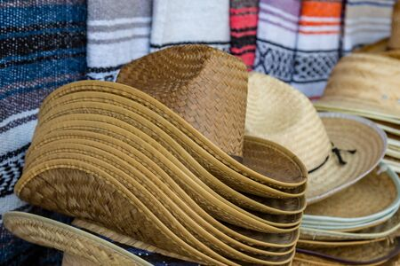 A pile of cowboy hats for sale