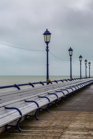 Empty benches on Eastbourne Pier during winter