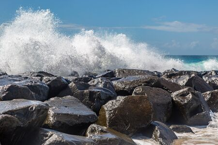 Waves crashing over rocks, on the island of Barbados Stock fotó