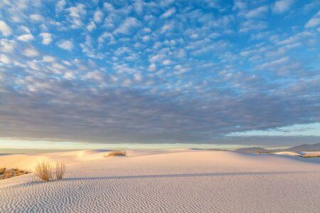 Clouds over the gypsum sand at dawn, in White Sands National Monument, New Mexico