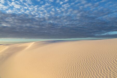 Clouds over White Sands Desert in New Mexico, at Sunrise