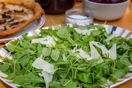 A green salad on an outdoor dining table, ready for a summer lunch Banco de Imagens