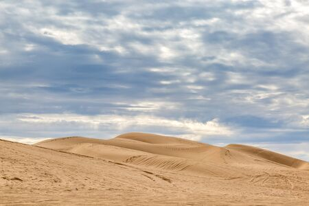 The Imperial Sand Dunes with dramatic clouds overhead