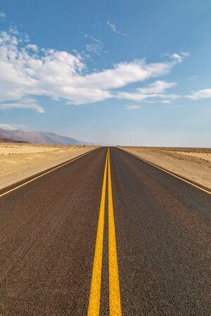 A long road through the Death Valley desert, in California