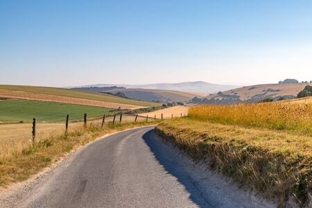 A road through a Sussex patchwork landscape, taken during a dry summer