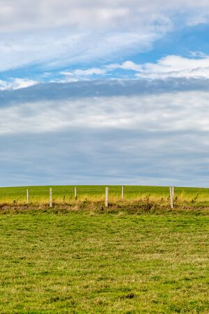 Fields and a fence on the Isle of Wight with clouds overhead