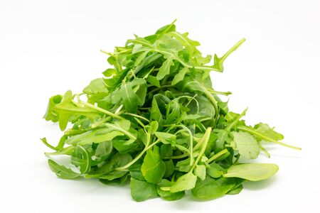 A studio shot of mixed watercress, spinach and rocket against a white background