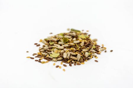 A pile of mixed seeds against a white background