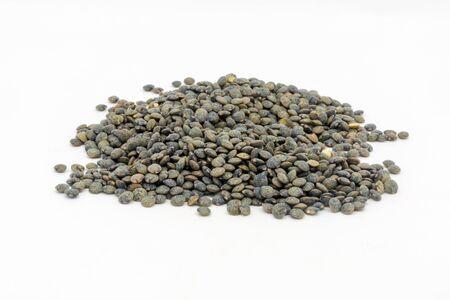Dried puy lentils against a white background Foto de archivo