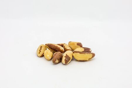 Shelled Brazil nuts against a white background