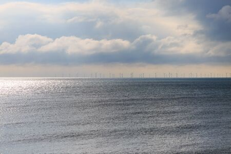 A wind farm on the horizon, off the coast of Brighton in Sussex