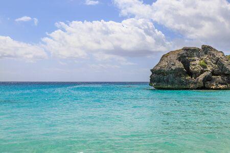 A rock in the calm sea in Bermuda.