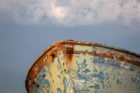 Looking up at part of an old weathered hull of a boat