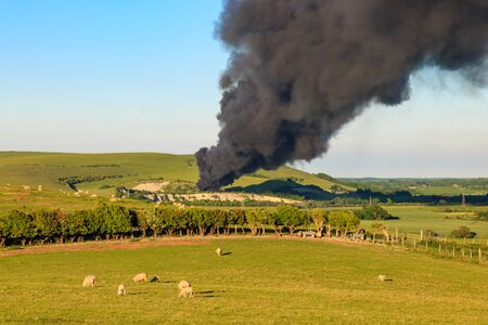 Black smoke plumes over the South Downs near Lewes, East Sussex