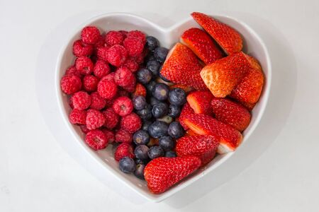 Raspberries, Blueberries and Strawberries in a Heart Shaped Bowl