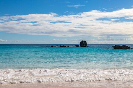 Looking out over the ocean from the sandy beach, at Horseshoe Bay on the Island of Bermuda