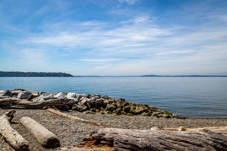 Looking out over the calm water of Elliott Bay, in the city of Seattle