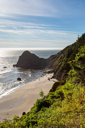 Looking along the Oregon coast at Nesika Beach, on a sunny summers day