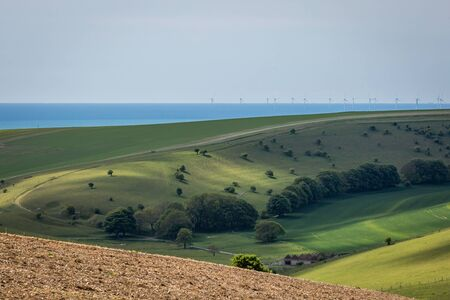 Looking out over the rolling landscape of the South Downs with the Sussex coast in the distance