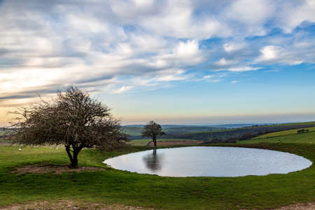 A dew pond on the top of Ditchling Beacon on a sunny autumn morning