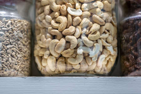 Shalled cashew nuts on a shelf in a kitchen
