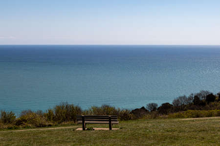 A bench with a view out to sea, on the Sussex coast