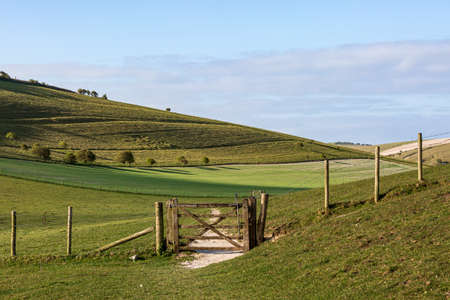 A Gate and Pathway in the South Downs on a Sunny Spring Morning Imagens