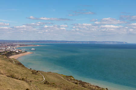 A view towards Eastbourne on the Sussex coast, on a sunny spring day Imagens