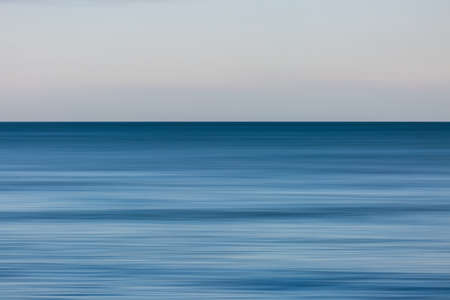 A calm seascape with intentional camera movement