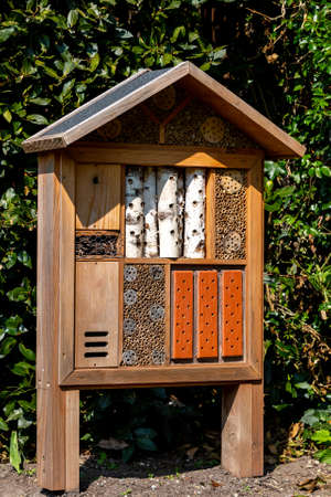 A wooden Bug Hotel Providing Shelter For Insects