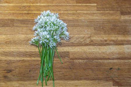 Wild Garlic Flowers on a Wooden Background