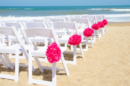 Wedding chairs set up for a ceremony at the seashore