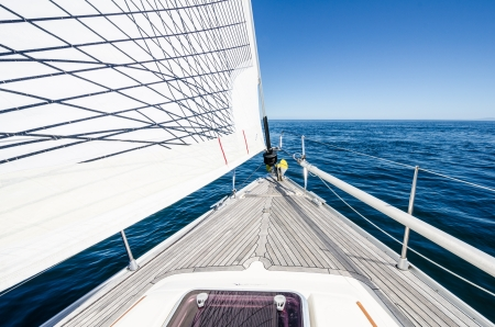 Bow of sailboat at sea on a clear sunny day