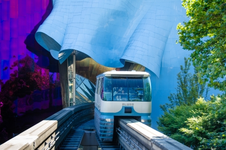 frank: Seattle, United States, August 6, 2013 - The Monorail enters the 1962 World s Fair site through the ultra-modern EMP Museum designed by architect Frank O  Gehry  Editorial